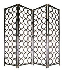 Legends Screen. Elegant and glamorous folding screen made of all natural rattan in a chocolate brown finish. It has four hinged panels and a lovely linked circle design.  Each of the four panels measures W560 x H1800.