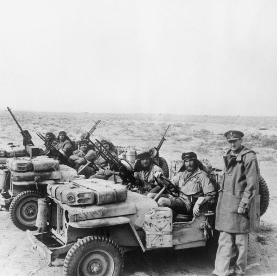 A Special Air Service jeep patrol is greeted by its               commander, Colonel David Stirling, on its return from the               desert. 18 January 1943.