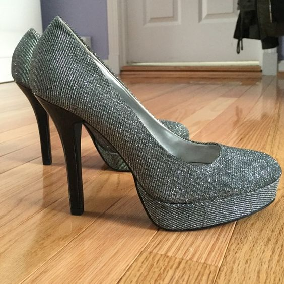 Silver and black sparkly heels Only worn once size 7 heels. Perfect for any formal occasion. They are a sparkly silver with a black heel and sole. 9 & co Shoes Heels