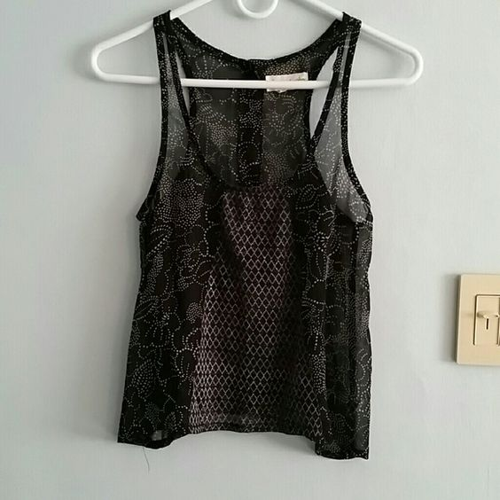 Urban Outfitters Top This is a sheer top designs with floral designs all around.  It had a criss cross design on the front and uttons that go down the back. Urban Outfitters Tops Tank Tops