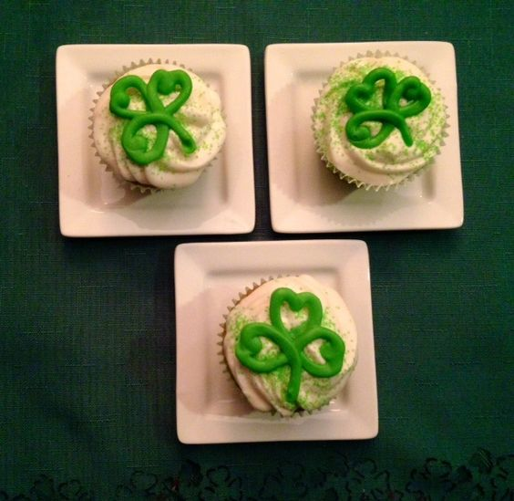 Irish cream cupcakes, using a white cake mix, substitute half the water for Irish cream liquor and add Irish cream to the frosting.  Melt white chocolate, add green food coloring and squeeze shamrocks with a large round decorating tube and pastry bag onto foil and let dry. Peel off and add to top of cupcake.