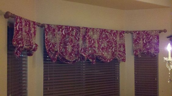 i made these curtains from a holiday tablecloth from tj maxx, i cut it up and used tape for no sew holiday curtains;)