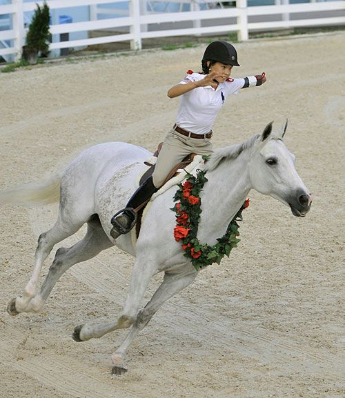 Lizzie Traband was born without a left forearm but has not let her disability stop her from becoming a horse trainer and performer – by the young age of 13. She has performed at the World Equestrian Games and numerous expos, and developed her own training program, Taiji Horsemanship, at age 9.