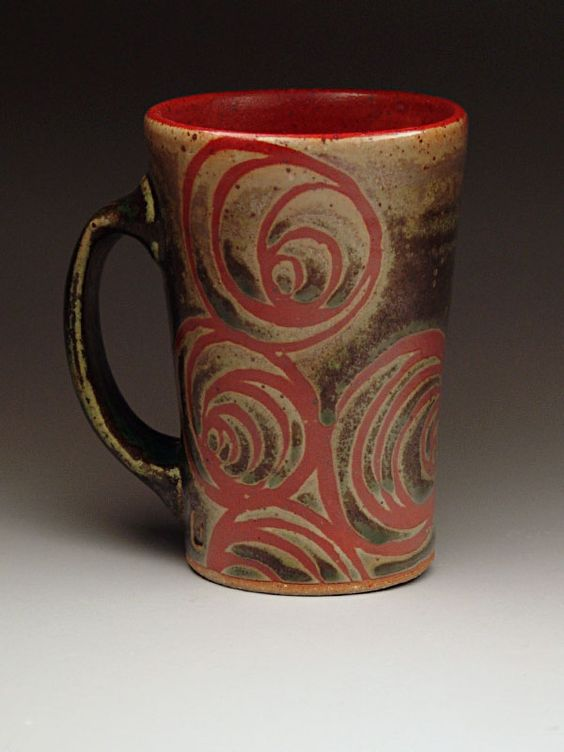 i can make this design with one glaze, then fire, then wax in circle designs then another glaze then fire