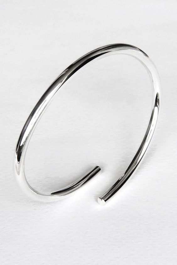 Bangle bracelet - Sterling silver oval chunky bangle, solid heavy gauge round wire, 6 gauge/4 mm, modern minimalist design, limited edition - on Etsy, by Edith Toledano, Israeli jewelry designer/silversmith. Read more at https://www.etsy.com/listing/202363463/sterling-silver-bangle-bracelet-thick