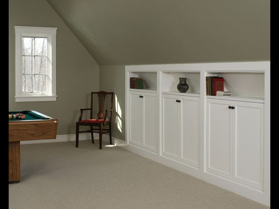 Kneewall storage built-ins - great for over garage bonus room. Love these for an attic conversion or loft.: