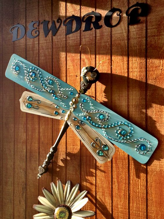 Dragonfly made by Laurie (Dewdrop Jewelry) Baker-- An idea I found on Pinterest. I decorated mine with misc old jewelry and glass beads.  You will need ceiling fan blades and a spindle (or table leg) for the body. Attach with screws. Head could be wooden ball or styrofoam.(inspiration only)