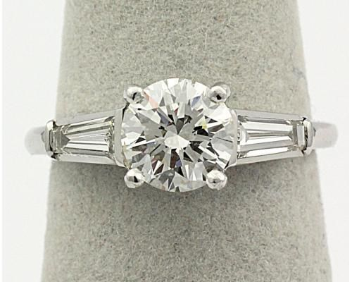 1.12 ct round center stone with 0.30 tw tapered baguettes