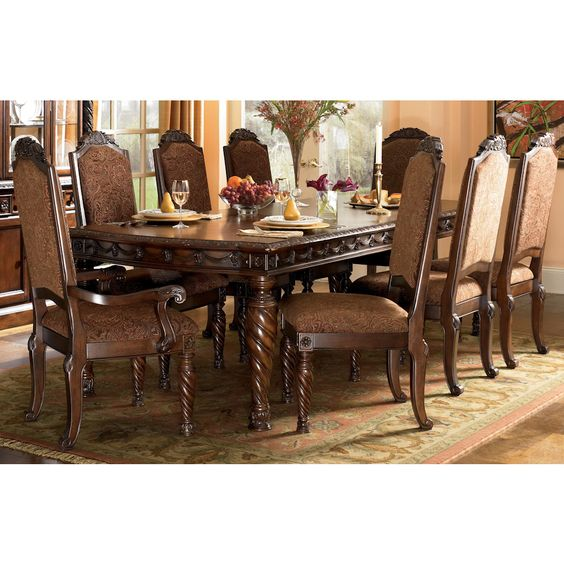 A deep rich stained finish and exquisite details come together to create the ultimate in grand traditional design with the elegance of the North Shore dining room collection. #bernieandphyls #diningroom