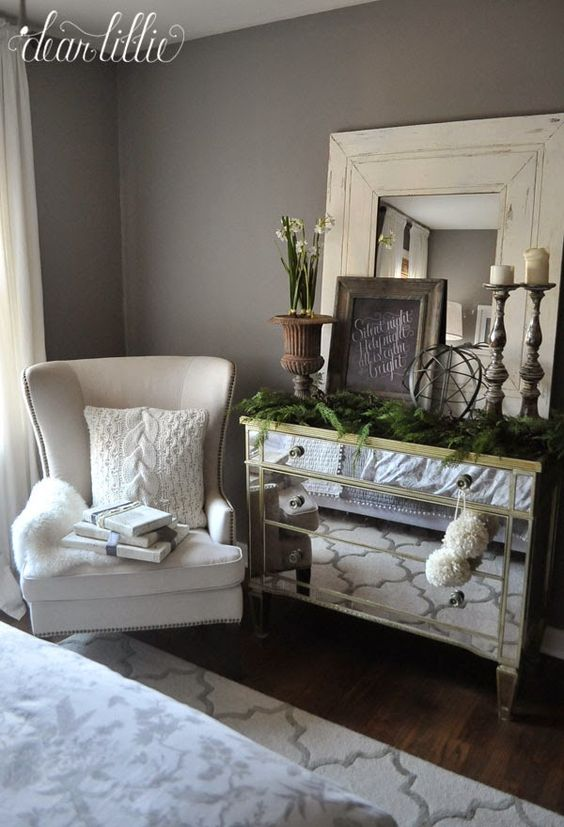 from homegoods adds a fun modern touch to this dark gray bedroom