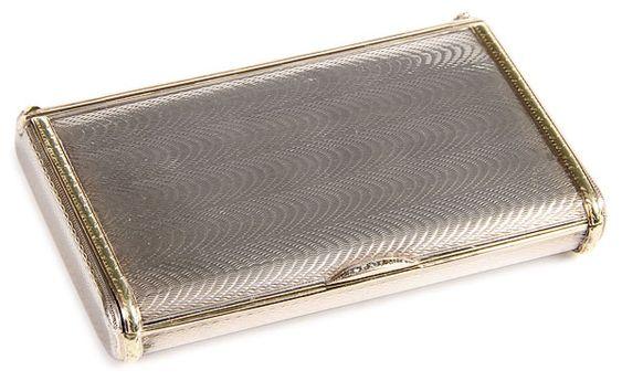 FABERGE SILVER & GOLD ENGINE TURNED CIGARETTE CASE, ST. PETERSBURG 1908-1917, FEODOR AFANASSIEV. The surface engraved with a moiré silk pattern with gold chased banding and diamond set thumbpiece.