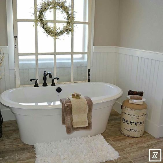 A few country touches and a new but sort of antique style tub keeps this charm intact