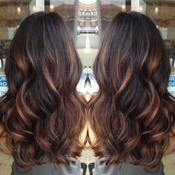 Brown with bronze highlights.... when my hair gets longer