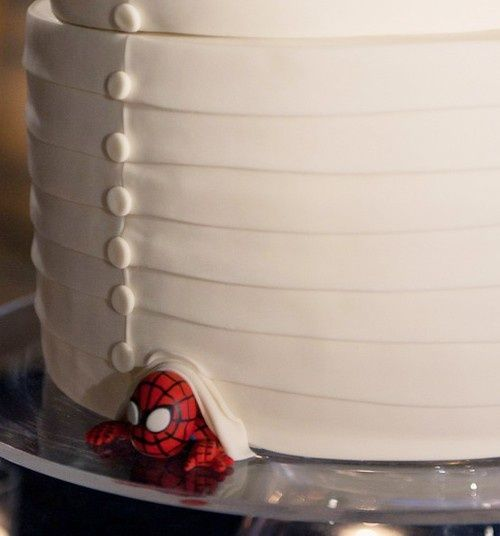 At the bottom of the cake, hide whatever the groom likes. I love it!