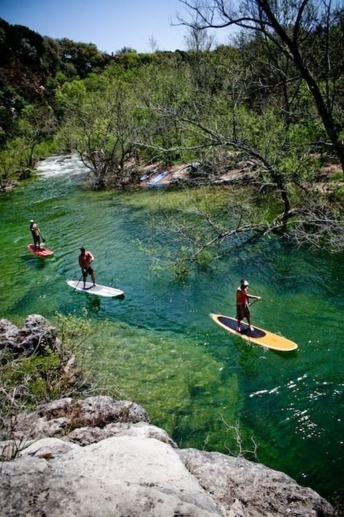 Paddle boarding or Kayaking in lady bird lake, Austin, Texas