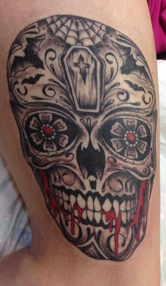 Skull tattoos daisies and vampires on pinterest for Vampire skull tattoo