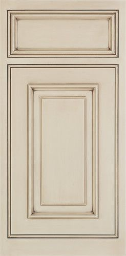 creme colored cabinets with a dark glaze