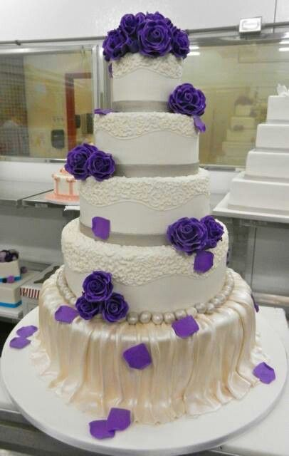 Beautiful cake by Cake boss - 5 layered cake with purple flowers.
