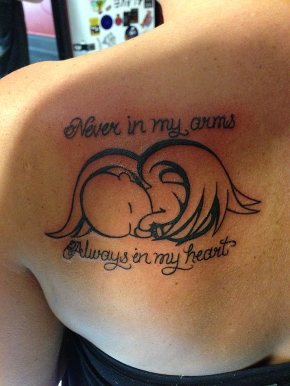 Tattoo reminds me of our sweet angel we lost so long ago.: