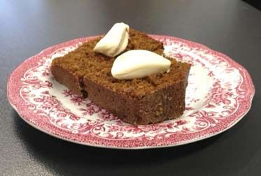 Gingerbread cake with cream on a plate