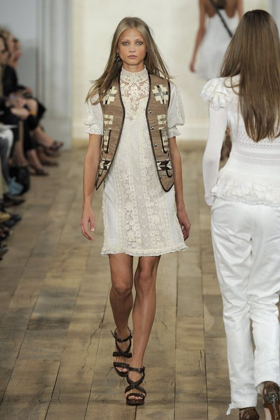 Pin for Later: 71 Iconic Runway Looks That Show the True Spirit of Ralph Lauren Spring 2011 The Southwestern theme was carried further when a lace white dress came down the runway with an embroidered vest.