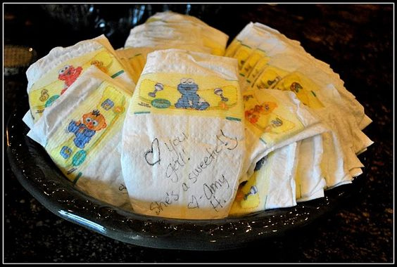 LOVE this idea for a baby shower....have guests write sweet notes on the diapers and mom can read them when she's up in the middle of the night changing! :)