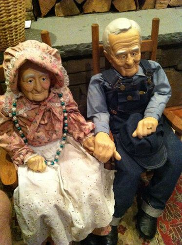 "This special find, had to buy them! An old man and old woman dressed in country attire. These 32"" OOAK dolls sit on their rocking chairs enjoying the married life. Bisque faces, hands, legs and feet. Love the details -- wedding rings, hats, necklace, overalls, sparkle in their eyes..."