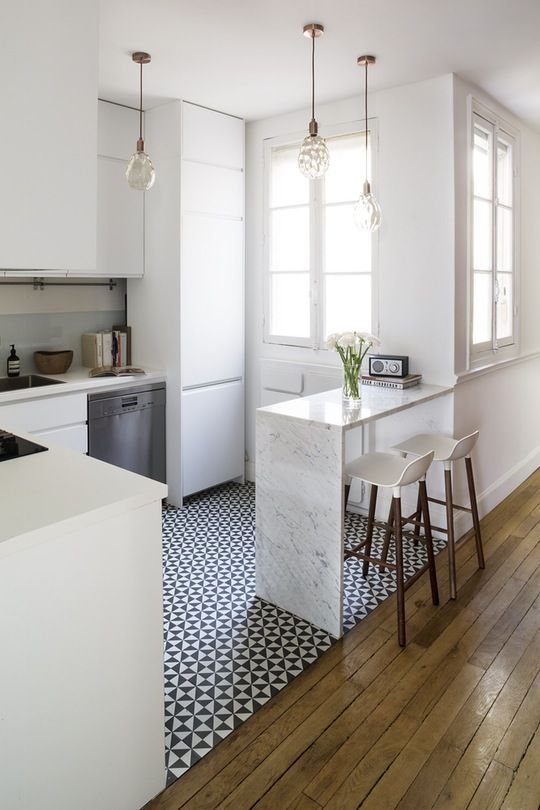 This Chic Paris Apartment Is a Perfect Mix of Old & New - great layout for a small kitchen!