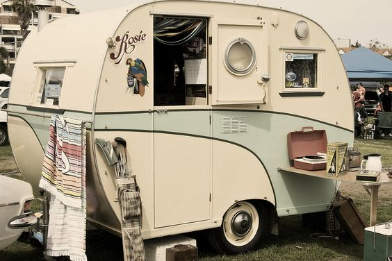 Not only is it a camper....it's a camper with a seafoam stripe.