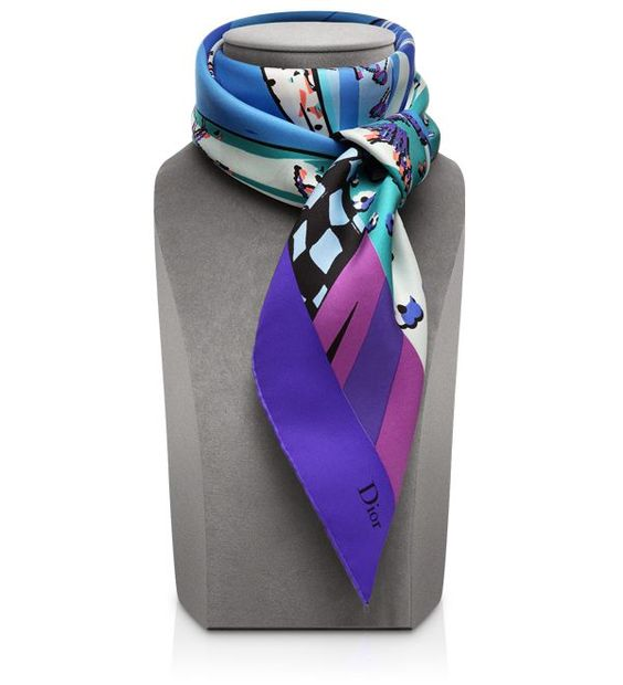Go asymmetric in vibrant colors with this new Dior scarf. It will lighten up your gloomy winter days with its gorgeous shades. Available in pink and purple.