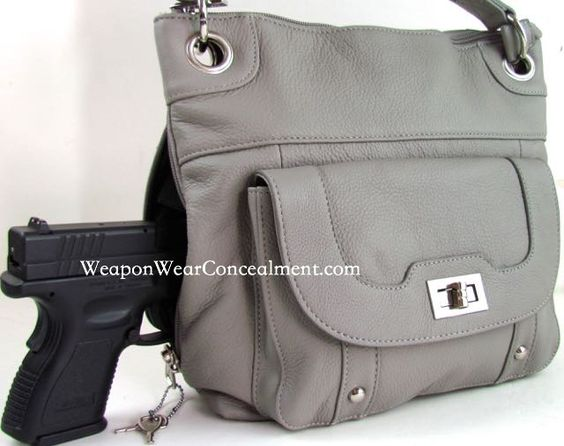 This concealment purse has modern attractive chrome grommets that the shoulder straps are attached to, through chrome rings.The gun compartment has a key lock