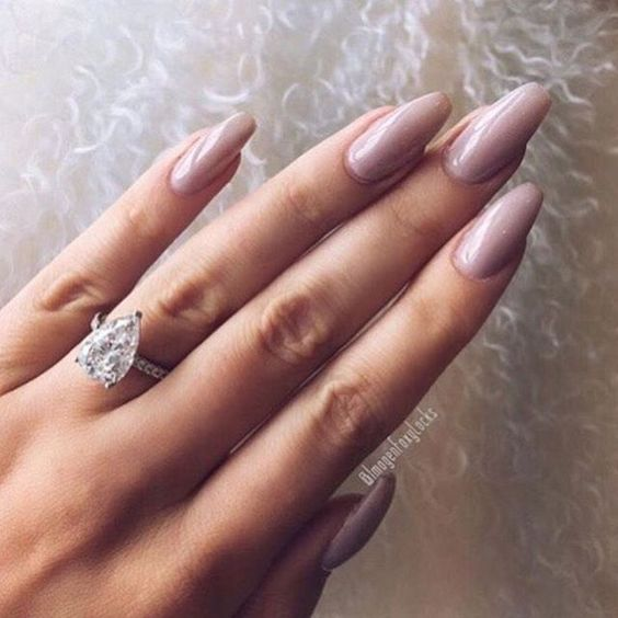 Mauve nail colour and pear cut engagement ring