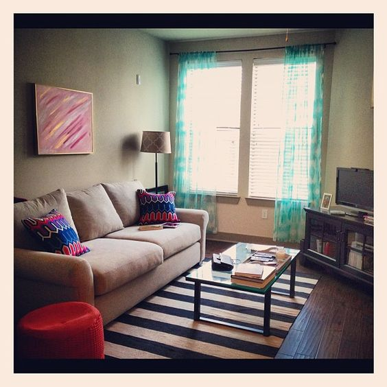 @Monica Woodhams finishes her colorful living room by draping our aquamarine Esha Panels.
