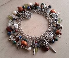Outlander Series Charm Bracelet by Jennie Ingram  http://www.craftster.org/forum/index.php?topic=409669.0#axzz2YfEOX7Hc