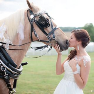 Country wedding photo shot - with her other great love!