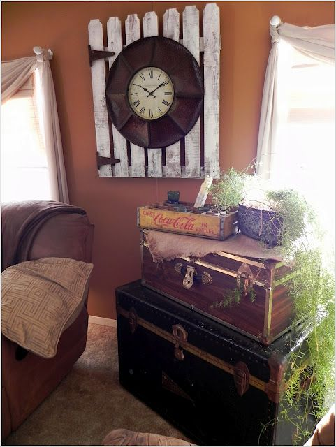 A Southern Belle with Northern Roots: Mobile Home, clock on old gate, and old trunks stacked for storage.