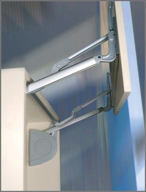 Vertical doors sliding door systems and garage cabinets on pinterest