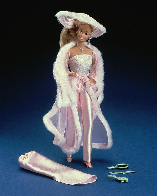 Pretty in Pink Barbie, I had this Barbie and loved it. And now, I am realizing she looks like a cross between a hooker and a pimp! LOL