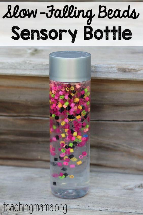 Slow-Falling beads sensory bottle - such a pretty idea!