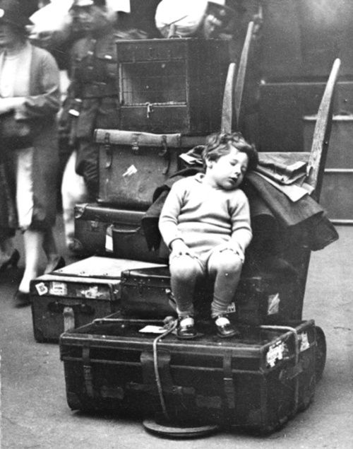 I don't know the story behind this photo, but perhaps they are immigrants from some far away land. I'd like to think this tired little child became a happy successful person here in America.