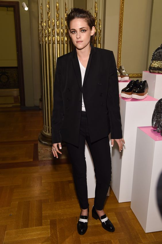 Kristen Stewart.  For the preview of Stella McCartney's AW15 collection,K-Stew did the monochrome thing in an oversized blazer, white T and slip-on shoes combo.   - Cosmopolitan.co.uk