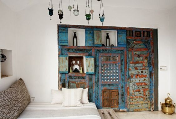 Love!!! wall unit made from old wooden doors and windows