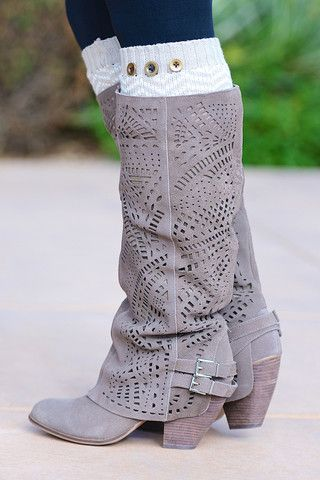 Suede leather perforated boots! Genuine suede leather is intricately punched with lace-like geometric designs along a slouchy shaft and two silver-buckled accen
