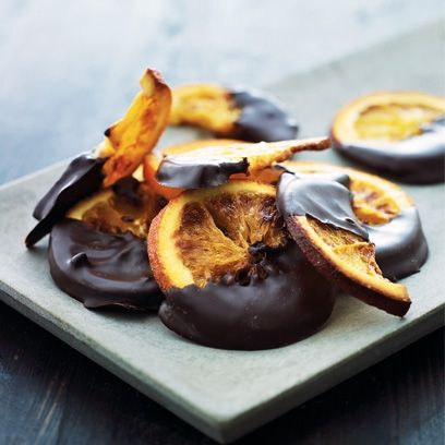 Could these candied oranges with rich, dark chocolate look any more delicious? www.redonline.co.uk