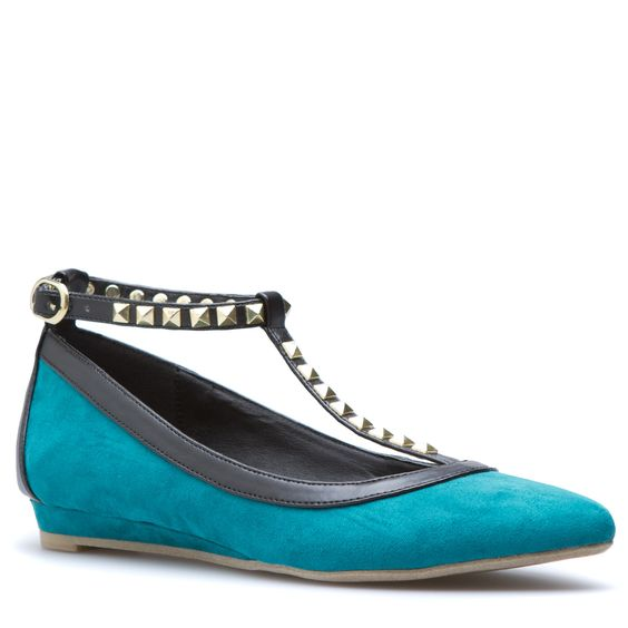 Shala shakes up the traditional ballet flat with edgy embellishments and a daring T-strap structure.