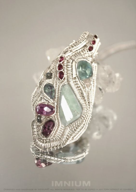 Aquamarine pendant  complex wire wrapped sterling silver by IMNIUM, $449.00 Not sure if I'm inspired or defeated!