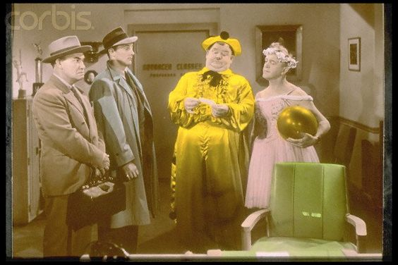 a young Robert Mitchum with Laurel & Hardy in the movie The Dancing Masters