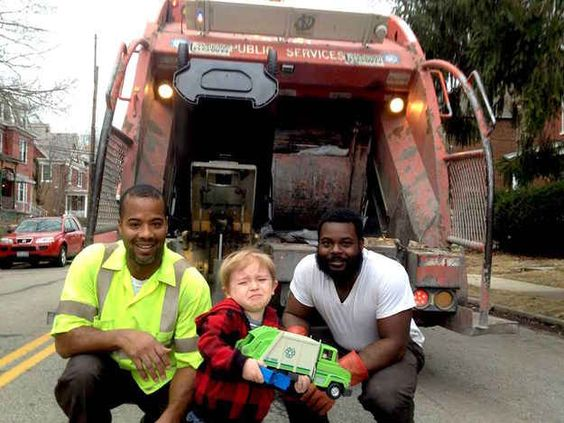 This is a picture of a little boy who was so excited to show the garbage men his garbage truck...he got a little emotional
