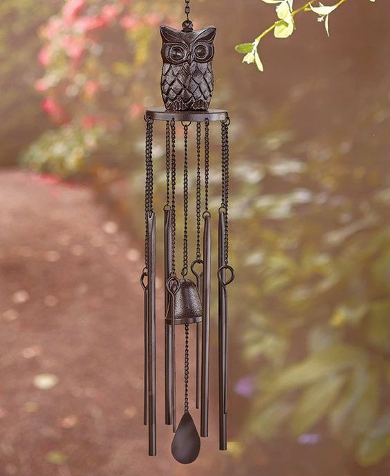 Add some melodic beauty to your yard with this Cast Iron Bell Chime. Its rustic look decorates your garden with the perfect touch of country style. A hook and c