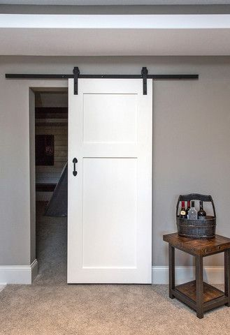Mudroom cabinets basement bedrooms and sliding doors on for Basement sliding doors